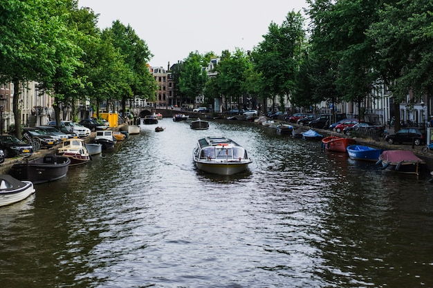 Amsterdam canals, boats walk on water Free Photo