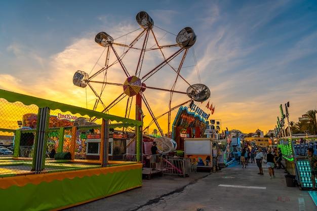 Amusement park at sunset in the coastal town of torrevieja, alicante, valencian community. spain, mediterranean sea Premium Photo