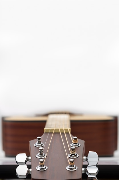 An Acoustic Guitar Headstock On White Background Photo Premium