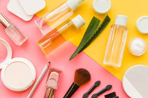 An overhead view of cosmetics makeup and natural organic products on dual backdrop Free Photo
