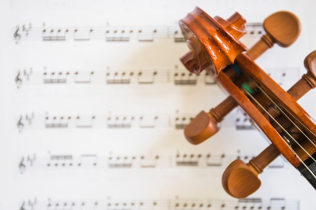 An Overhead View Of Violin Scroll And Strings On Musical Notes Photo