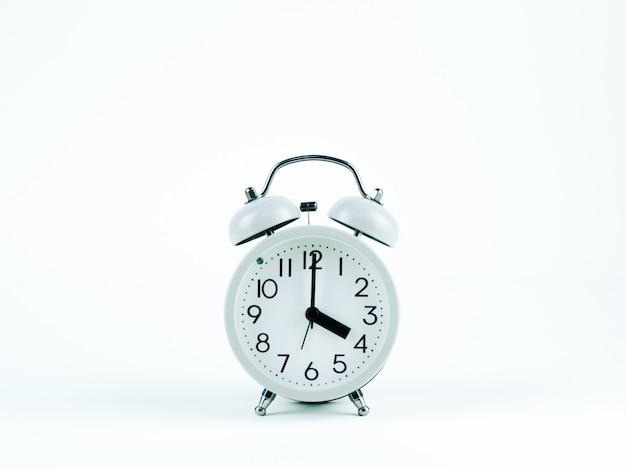 Analog clock on the white background Premium Photo