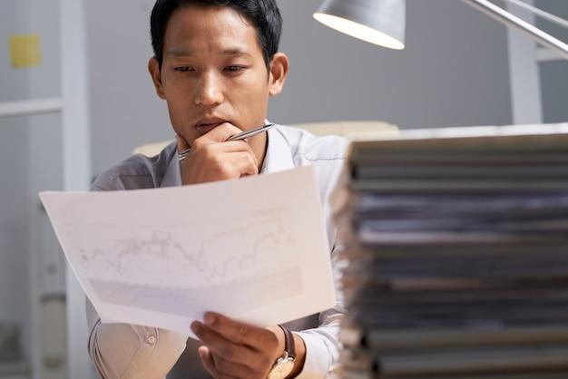 Analyzing business chart Free Photo