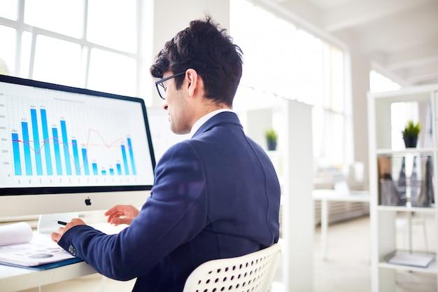 Analyzing financial statistics Free Photo