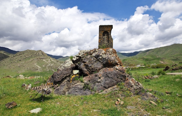 The ancient black church in the mountains of the caucasus, armenia Premium Photo