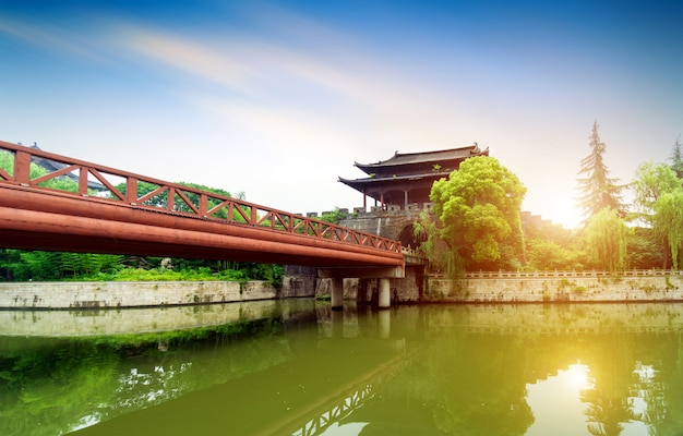 Ancient city wall by the river with a sunset view Premium Photo