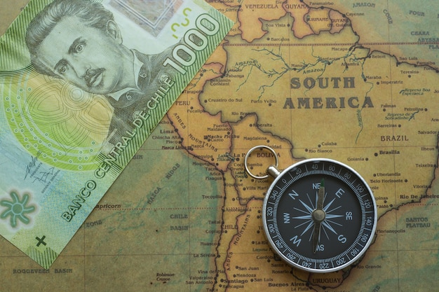 Ancient Map Of South America With Chilean Money And A Compass Photo