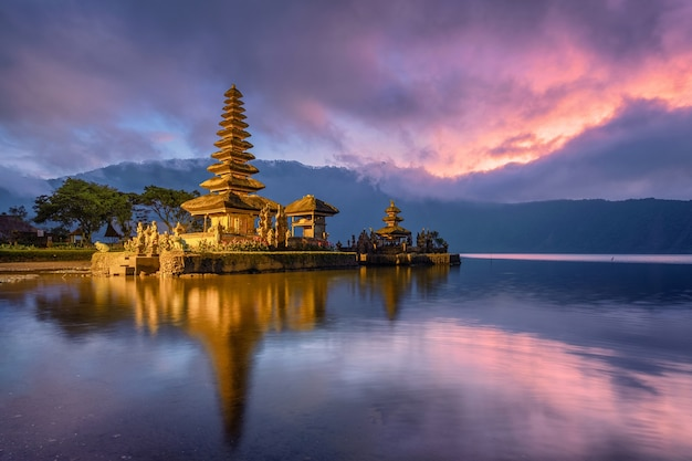 Ancient pura ulun danu bratan temple reflection with colorful sky at sunrise Premium Photo