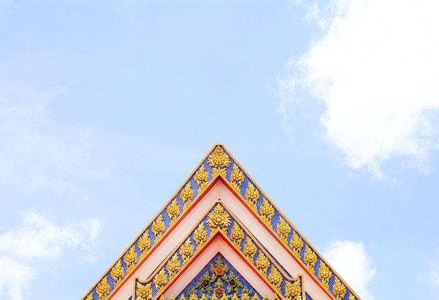 Ancient thai stucco pattern art on roof at temple - buddha temple in thailand Premium Photo