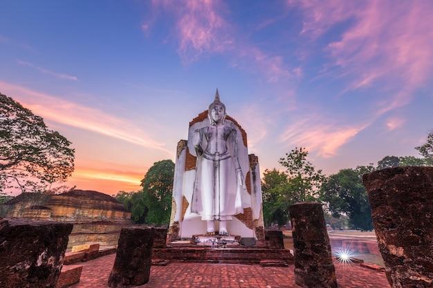 Ancient white buddha statue beautiful at sunset is a buddhist temple Premium Photo