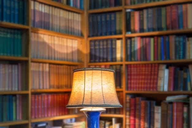 Angle library of old books and knowledge. the lamp shade in the foreground. Premium Photo