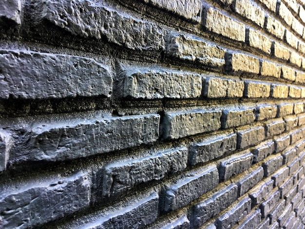 Angle Side View Of Black Brick Wall Premium Photo