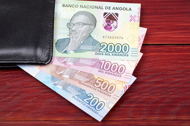 Angolan money banknotes in the black wallet Premium Photo