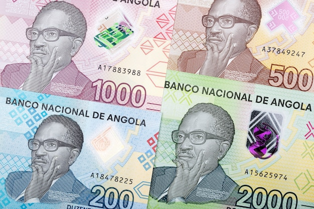 Angolan money banknotes composition Premium Photo