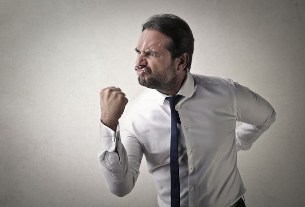 Angry aggressive businessman Premium Photo