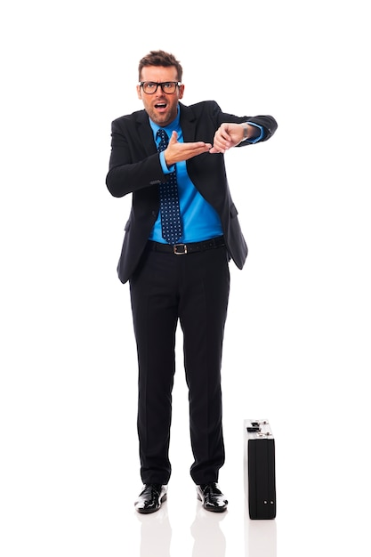 Angry businessman waiting for late business partner Free Photo