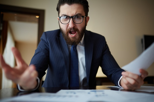 Angry businessman with glasses Free Photo