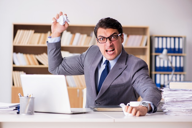 Angry businessman working in the office Premium Photo