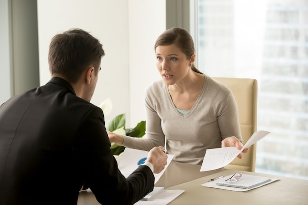 Angry businesswoman arguing with businessman Free Photo