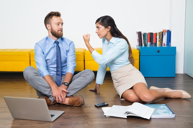 Angry gesture showing multiethnic colleague Free Photo