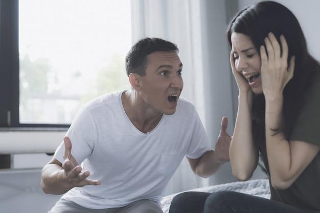 Angry husband screams at wife during quarrel Premium Photo