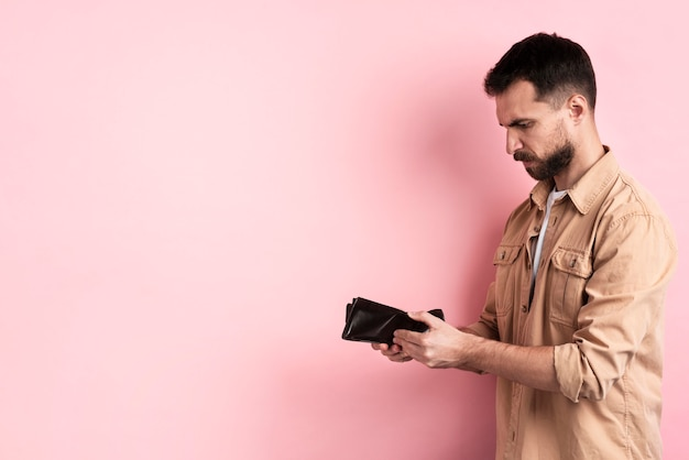Image result for man looking at wallet