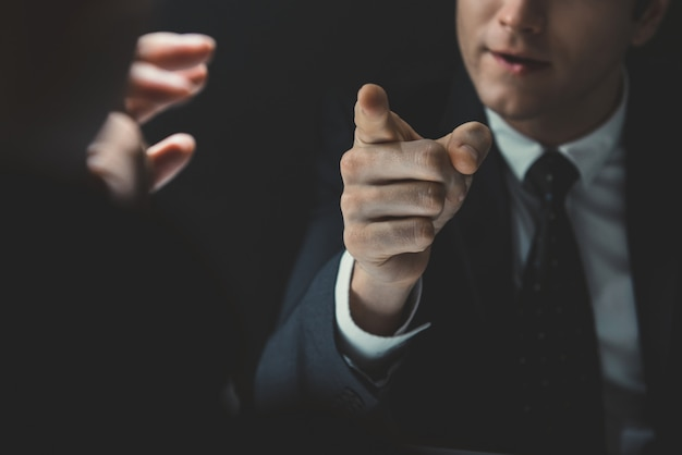 Angry man pointing hand to someone he is talking to Premium Photo