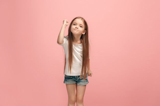 Angry teen girl standing on trendy blue studio Free Photo