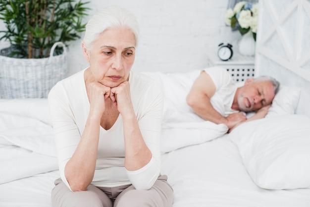 Angry  and tired elder woman awake Free Photo