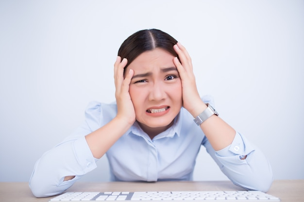 Angry woman screaming out and pulling her hair Premium Photo