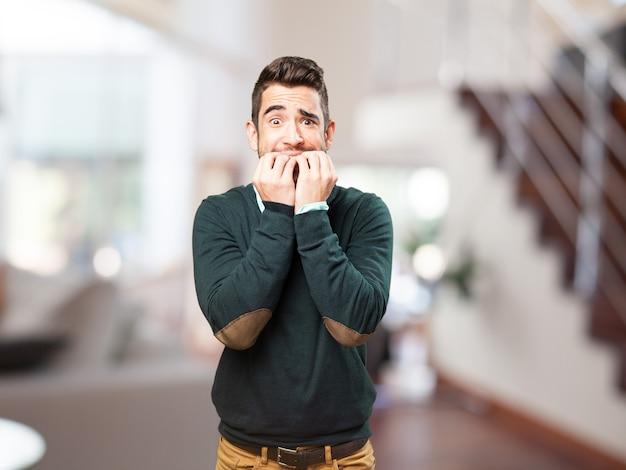 Anguished man biting his nails Free Photo