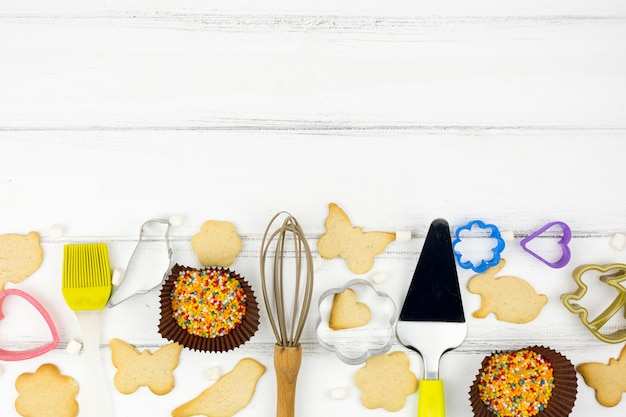 Animal shaped cookies with kitchen utensils Free Photo