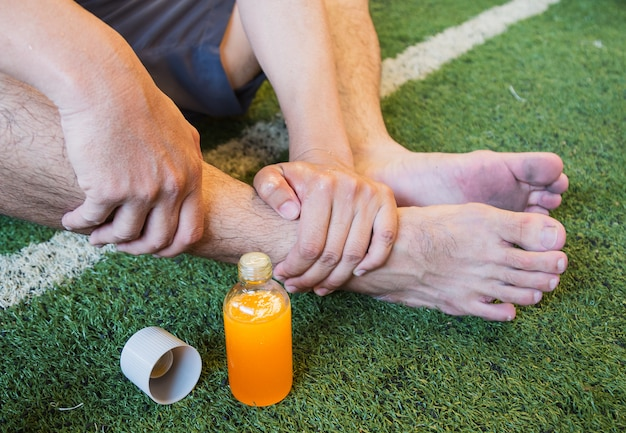 Ankle injury of football player, sports injuries. Premium Photo
