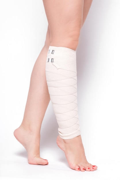 Ankle woman dragged elastic bandage Premium Photo