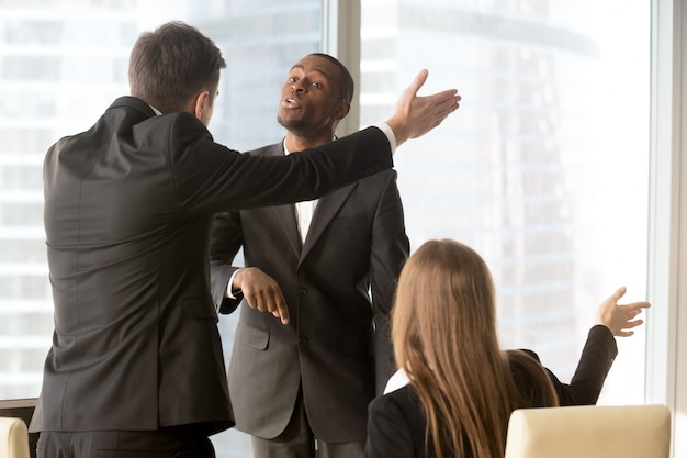 Annoyed business partners arguing during meeting Free Photo