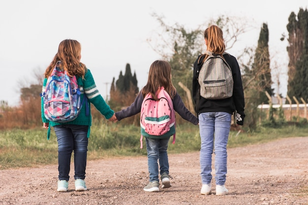 Anonymous kids walking to school Free Photo