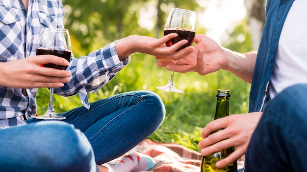 Anonymous lovers giving glass of wine each other Free Photo