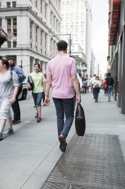 Anonymous man walking to work Free Photo