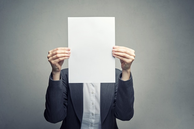 Anonymous woman covering face with  paper sheet Premium Photo