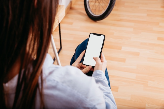 Anonymous woman surfing smartphone at home Free Photo