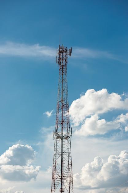 Antenna repeater tower on blue sky. Premium Photo