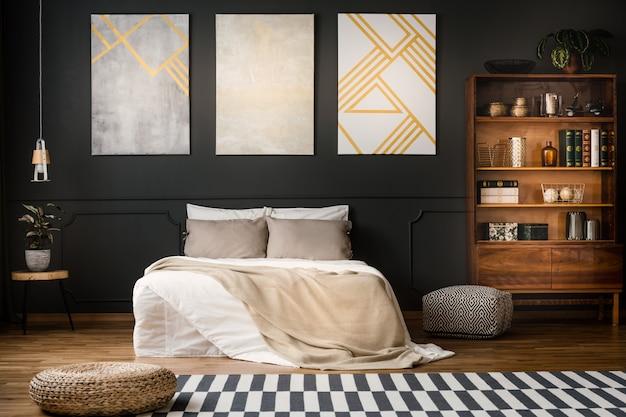 Antique bookcase in dark bedroom Premium Photo