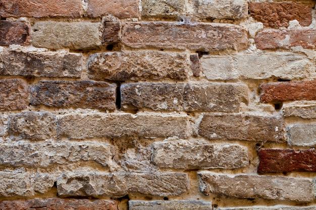 Antique brick wall texture. Premium Photo