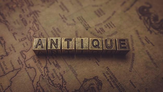 Antique bronze wording cube on old world map Premium Photo