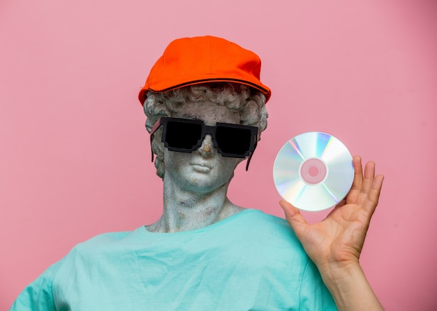 Antique bust of male in cap with sunglasses and cd Premium Photo