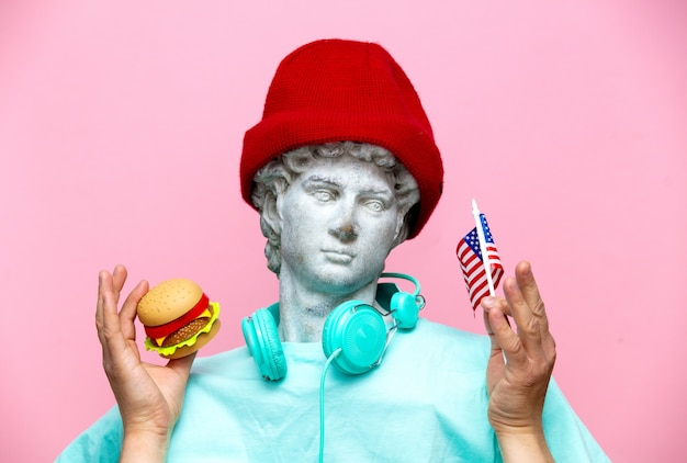 Antique bust of male in hat with usa flag and hamburger Premium Photo