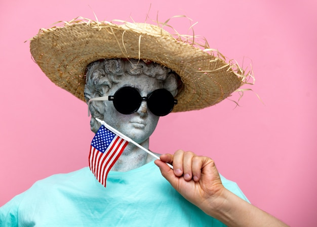 Antique bust of male in hat with usa flag Premium Photo