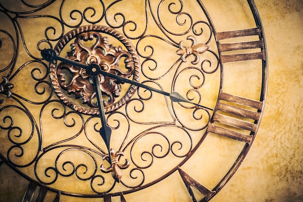 Antique clock on a wall Free Photo