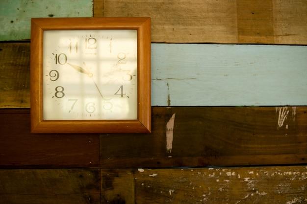 Antique clocks, wood wall hanging. Premium Photo
