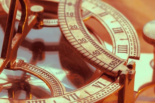 Antique compass on vintage style Premium Photo